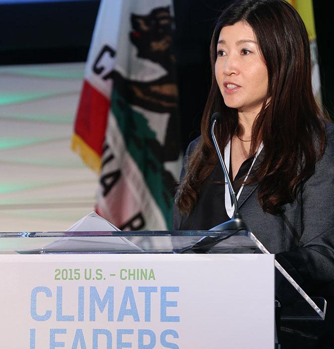 Nan Zhou speaking at the podium